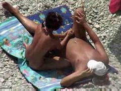 Giving him a handjob at the beach movies at adipics.com