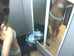 Girl in dressing room trying things on movies at kilovideos.com