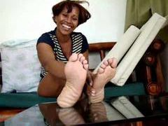 Black chick showing us her feet videos