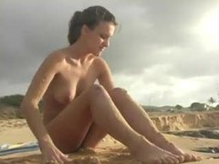 Sandy girl on a beach looks sexy movies at kilovideos.com