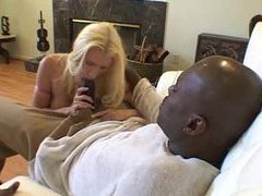 Pretty blonde with big tits takes huge black dick tubes