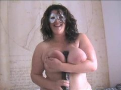 Masked bbw sits on huge toy videos