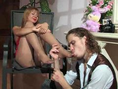 He sucks on her nylon-clad toes movies
