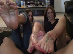 Two tremendous girls giving a footjob clip