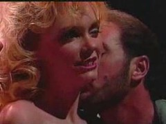 The scene features an audience and oral sex tubes
