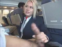 Stewardess gives a handy j on plane movies at freekilopics.com