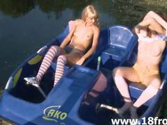 Two naked chicks having fun on the pond movies