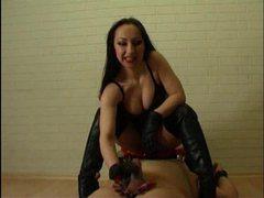 Dominatrix masturbates his cock in boots videos