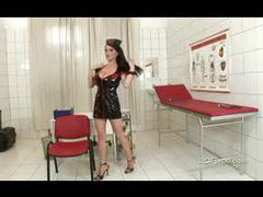 Nurse in latex dress showing big tits movies at kilopics.com