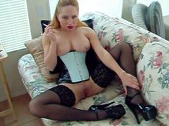 Chick in corset, heels, and stockings smoking videos