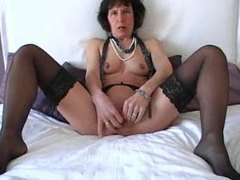 Mature in stockings masturbates her cunt movies at freekilomovies.com