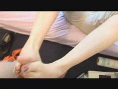 Pretty amateur in glasses gives a footjob clip
