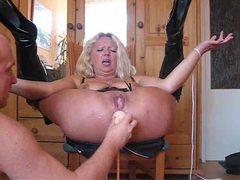 Mature in shiny boots has her ass toyed videos