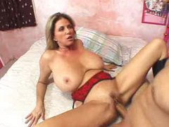Big tits and sexy boots on milf slut videos