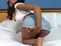 Black teen in bed stripping slowly tubes