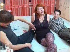 Redhead in hot stockings does threesome movies at freekiloclips.com