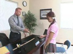 Schoolgirl in pigtails sits with teacher videos