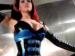 Redhead posing solo in great rubber movies at nastyadult.info