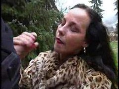 Chick in fur coat giving handjob outdoors movies at sgirls.net