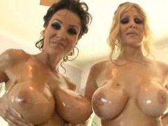 Two oiled up sluts do a foursome videos