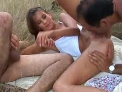 Two guys fuck a teen in a grassy field movies at freekilomovies.com