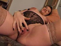Solo pregnant hottie uses a toy for fun videos