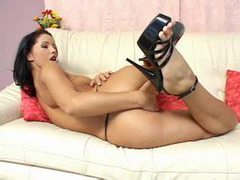 Solo girl in black heels playing with a toy videos