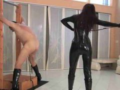 Gal in latex catsuit whips her man hard movies