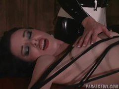 Girl tied down by her latex mistresses clip