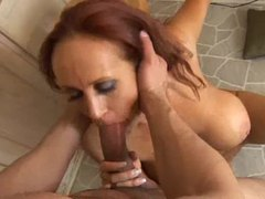 Sultry redheaded milf trying out anal sex videos