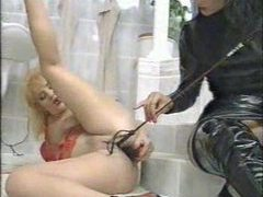 Dominatrix in black pisses on her submissive girl videos