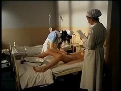 Nurses play while a man in a body cast watches movies at freekiloclips.com