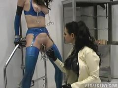 Rubber domme plays with her submissive videos