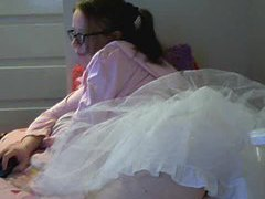 Cute girl in frilly skirt doing webcam chat movies at kilosex.com