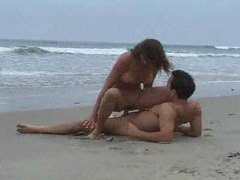 Couple having sex on an empty beach videos
