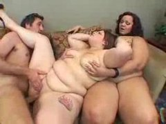 Two fat sluts and one slim guy playing videos