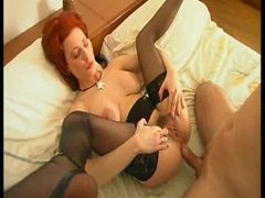 Sweet redhead in stockings takes two dicks videos