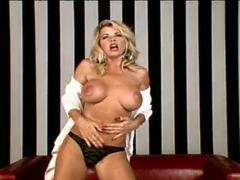 Girl with great tits doing a gorgeous striptease movies at lingerie-mania.com