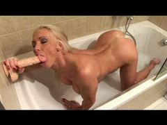 Hot blonde in the shower using a dildo videos