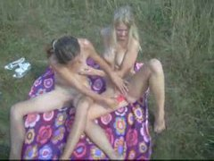 Lesbian couple playing lustily in the grass movies at sgirls.net