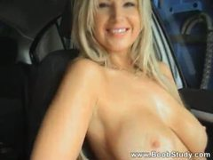 Flashing her big tits in the car videos