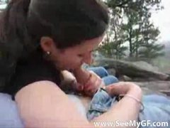 Couple outdoors while the girl sucks him clip
