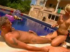 Hot blonde sucks cock and rides poolside movies at kilosex.com