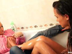 Fully clothed ladies get messy in the bathtub tubes