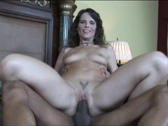 Brunette with tattoo having interracial sex videos