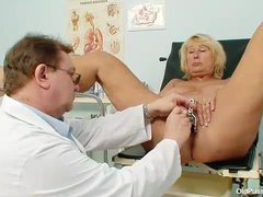 Doctor does a thorough exam with blonde mature videos