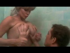 Busty cougar seduces younger man in the bathtub videos