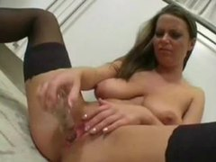Voluptuous chick in stockings toys pussy in kitchen videos