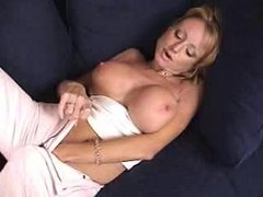 Milf in panties has big fake titties to model videos