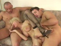 Skinny blonde in fishnets fucked in a threesome movies